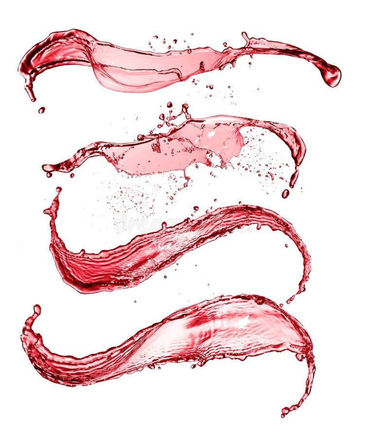 红葡萄酒摘要在白色背景飞溅形状 库存图片
