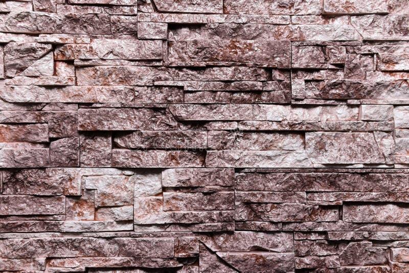 红褐色的石墙纹理背景自然颜色 库存图片