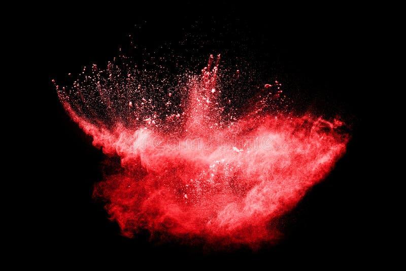 红颜色在黑背景的粉末爆炸 淡紫色红颜色云彩 库存图片