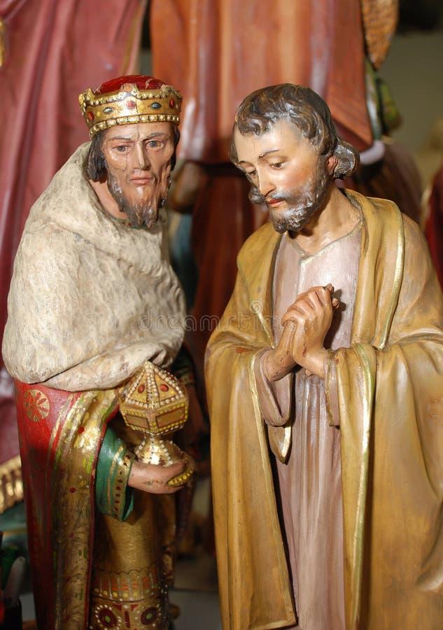 约瑟夫和国王古色古香的小雕象  免版税库存照片