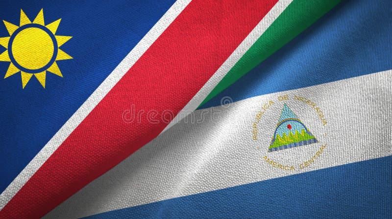 纳米比亚和尼加拉瓜两旗子纺织品布料,织品纹理 皇族释放例证