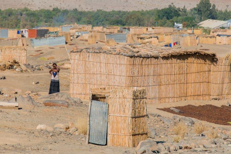 Download 纳米比亚-奥兰治河 图库摄影片. 图片 包括有 女性, 旅行, 天气, 住房, 岩石, 橙色, 村庄, 闹事 - 62538892