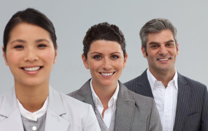 纵向三买卖人微笑 库存照片