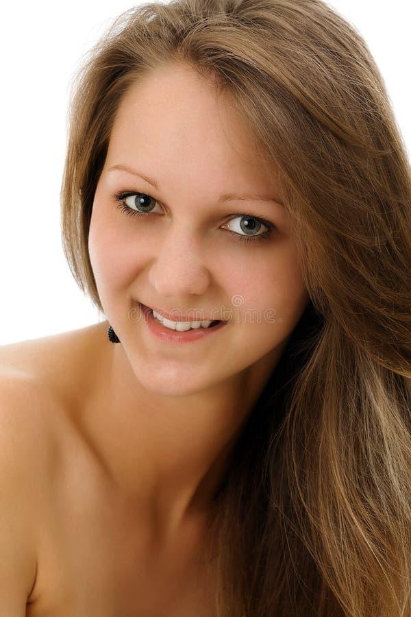 纵向俏丽的微笑的妇女年轻人 库存图片