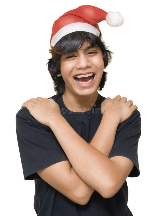 纵向圣诞老人少年 库存图片