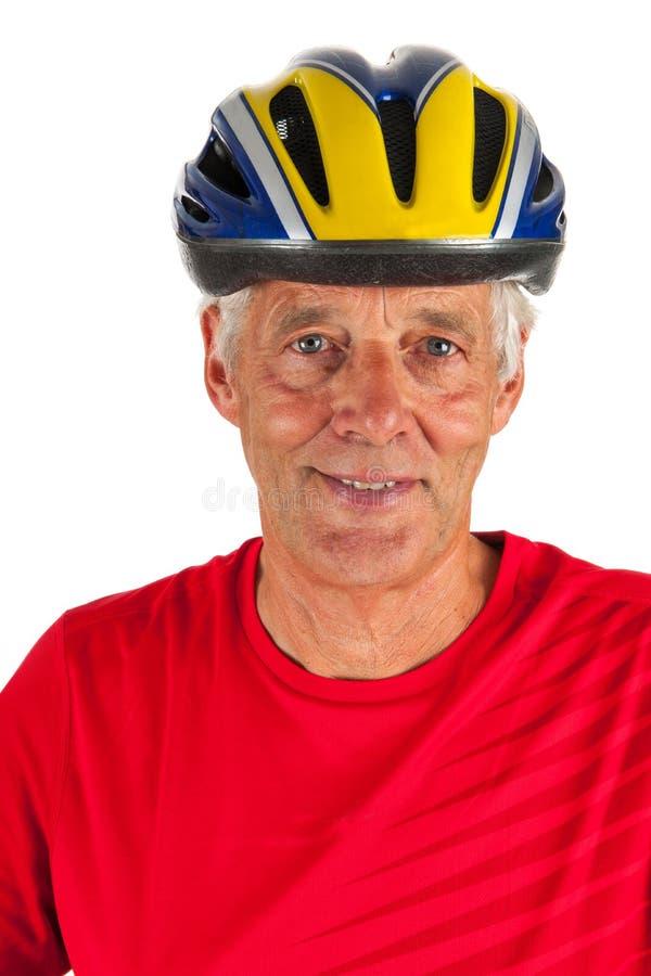 纵向年长的人骑自行车的人 免版税库存照片