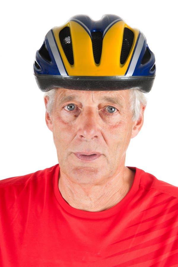 纵向年长的人骑自行车的人 免版税图库摄影