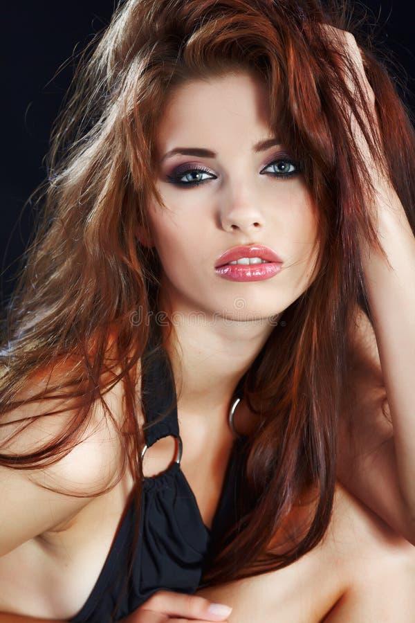 纵向性感的妇女 库存照片
