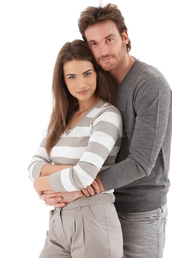 纵向有吸引力爱恋夫妇微笑 图库摄影