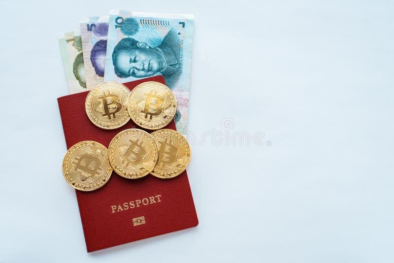 纸在红色护照白色背景中发单中国与中国货币元,金币bitcoin 免版税图库摄影