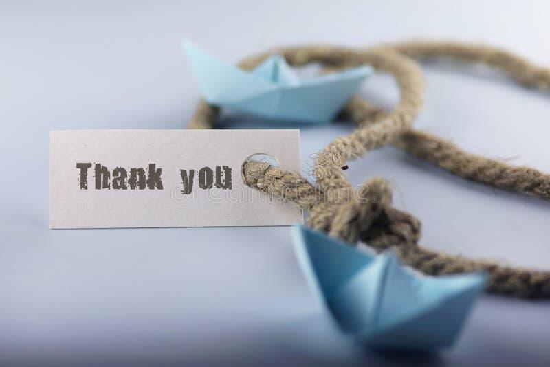贴纸感谢您有重结辨的绳索的并且运输纸origami 库存照片