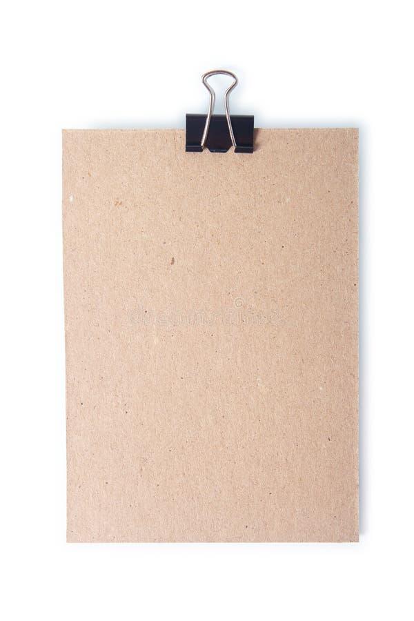 纸板单件别住与有裁减路线的一个纸夹。 免版税库存照片