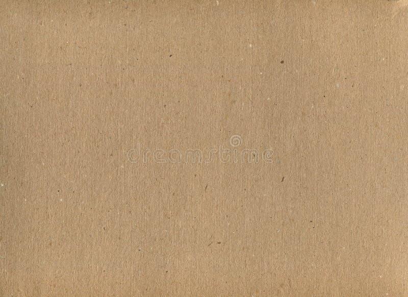 纸板背景 棕色牛皮纸的不均匀纹理 库存图片