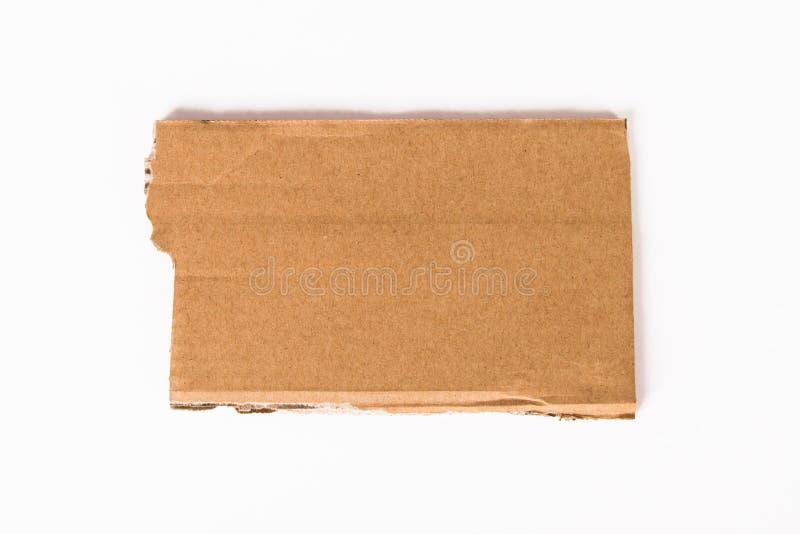 纸板被撕毁的片断  库存照片