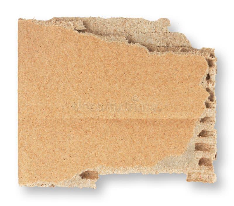 纸板被撕毁的片断  免版税库存照片