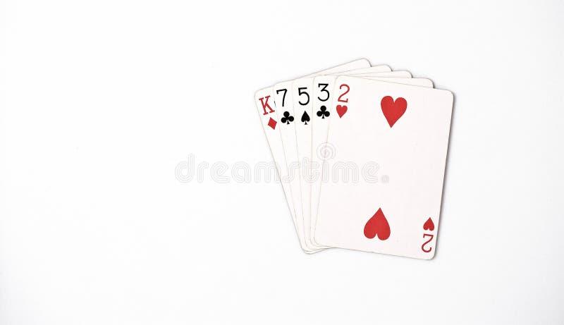 纸牌游戏手等级,符号集纸牌在赌博娱乐场:hight手,七国王,五,三,两在白色背景,运气abstra 免版税库存照片