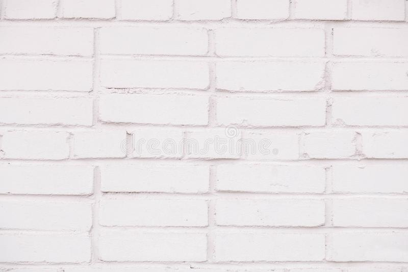 纹理白色砖墙背景的背景概念在农村屋子里 库存图片