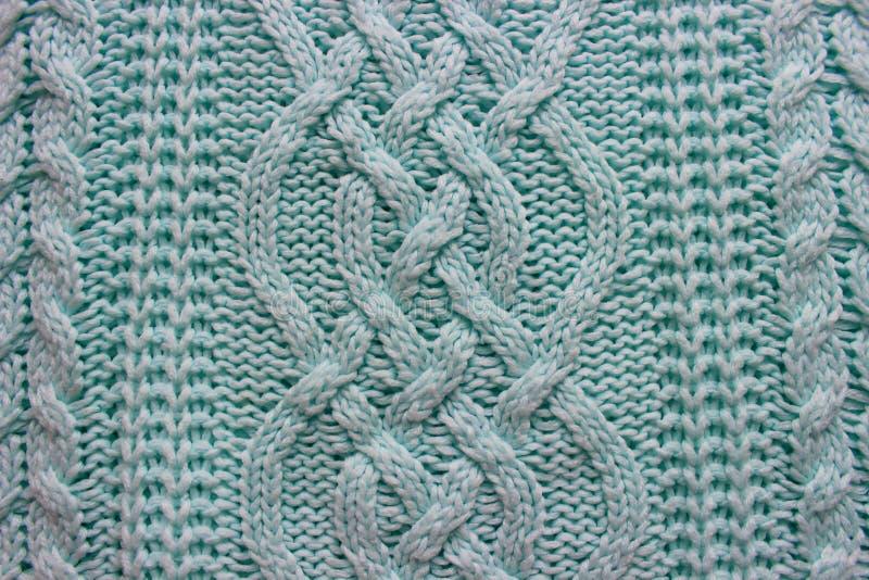 纹理被编织的手工制造 圣诞节蓝色毛线衣关闭 抽象背景 图库摄影