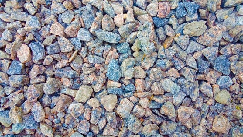 纹理:小铺沙的石渣 小白色,灰色和蓝色白垩石头 从自然物的艺术性的安心 物质为 库存照片