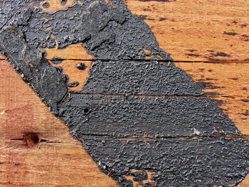 纹理 红色木板条墙壁,与报道的沥清踪影的土气结构纹理  免版税库存照片