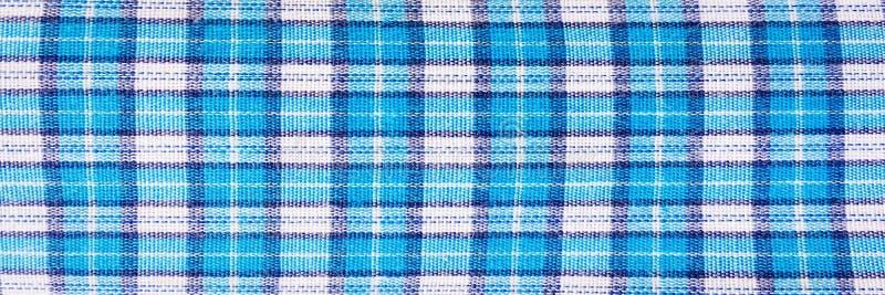 纺织品蓝色框,织品蓝色格子花呢披肩盖子 蓝色经典方格的样式 蓝色方格的织品特写镜头,桌布纹理 免版税库存图片