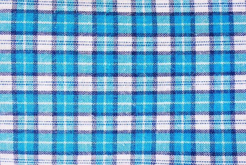 纺织品蓝色框,织品蓝色格子花呢披肩盖子 蓝色经典方格的样式 蓝色方格的织品特写镜头,桌布纹理 库存照片