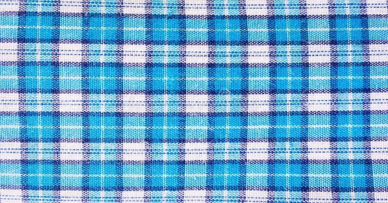 纺织品蓝色框,织品蓝色格子花呢披肩盖子 蓝色经典方格的样式 蓝色方格的织品特写镜头,桌布纹理 库存图片