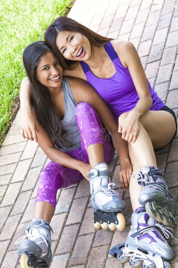 线的滑冰亚裔中国印地安妇女女孩 免版税图库摄影