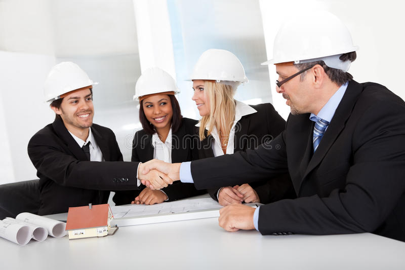 组建筑师在会议上 免版税库存照片