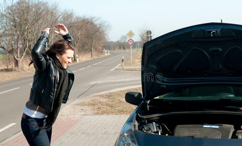 细分汽车有妇女年轻人 免版税库存图片