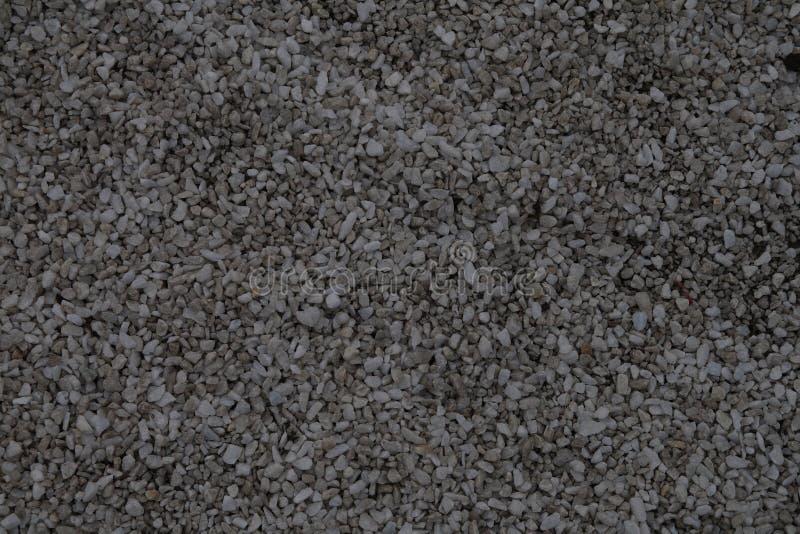 细致的成颗粒状的石渣灰色光 图库摄影
