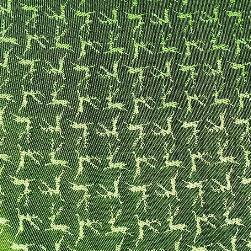 织品上色绿色,被仿造的纹理鹿 库存图片