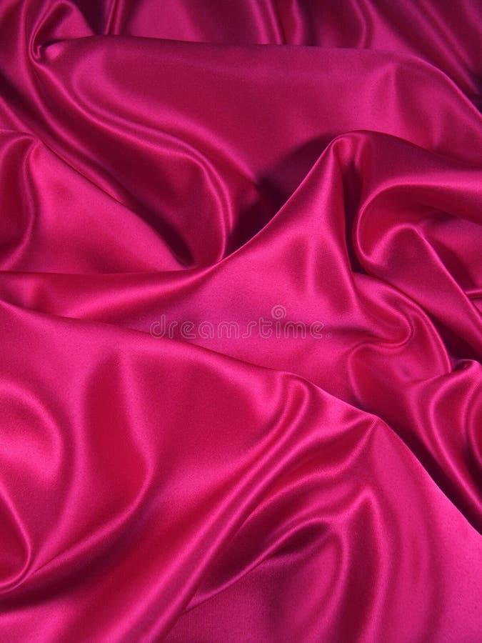 织品桃红色纵向缎 免版税库存图片
