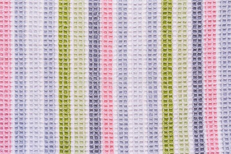 织品表面包括的多彩多姿的垂直条纹的纹理,抽象背景 免版税库存图片