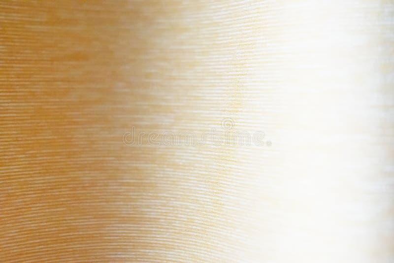 织品,精美金黄颜色,波浪 库存图片