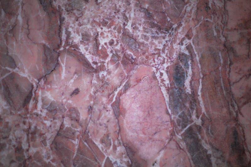 织地不很细大理石桃红色和紫色 库存照片
