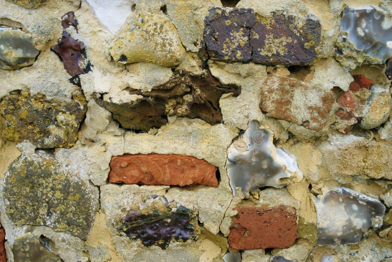 织地不很细火石和砖墙 免版税库存照片