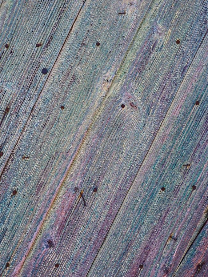 织地不很细老蓝色被绘的木门细节  库存图片