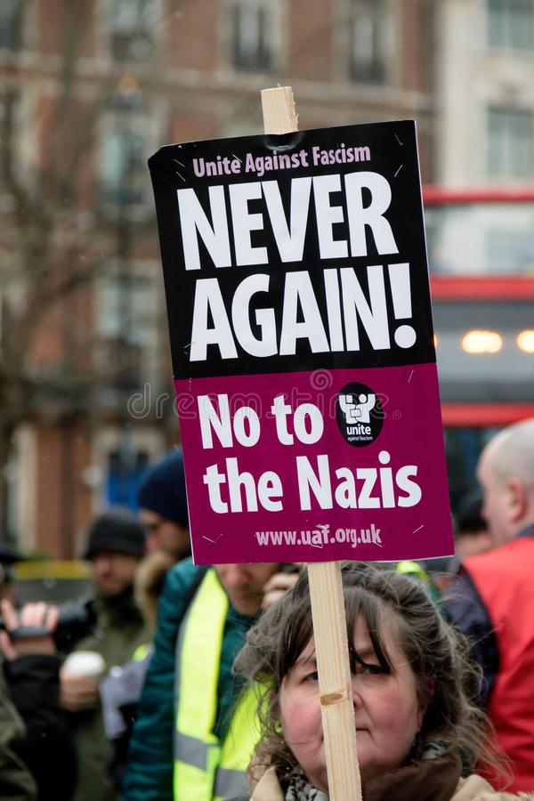 经受种族主义行军通过中央伦敦 免版税库存照片