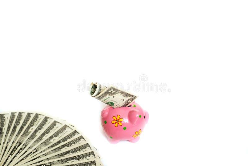经济的美国,金钱储款和投资概念,堆的美元票据,明白的复利白色存钱罐 免版税库存照片