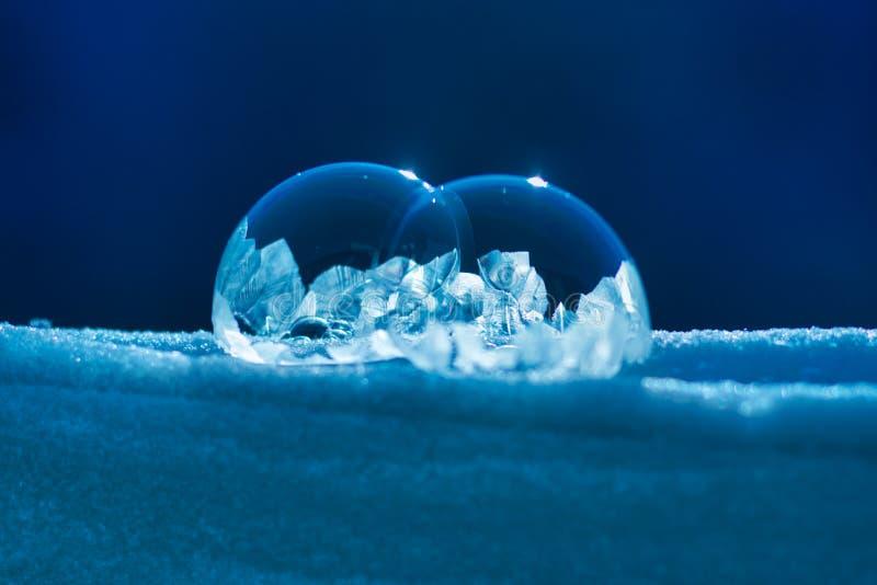 结冰在雪的两肥皂泡 免版税图库摄影