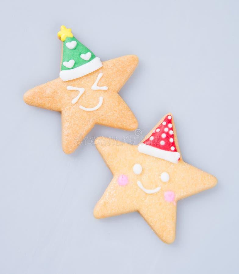 结块装饰或星形状圣诞节曲奇饼在背景 免版税图库摄影