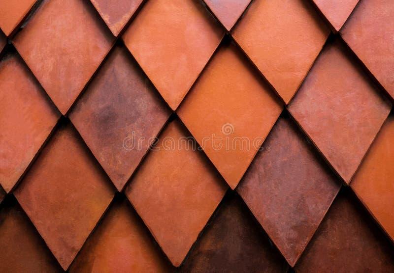 结束橙色菱形砖纹理  外部或室内设计的墙壁 大厦捆绑盖使用的拉脱维亚材料屋顶农村秸杆 背景概念 免版税图库摄影