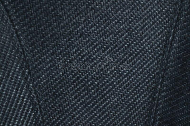 结束被布置的豪华扶手椅子织品纹理  优质缝和沙发表面上的被交叉涂画的样式 免版税库存照片
