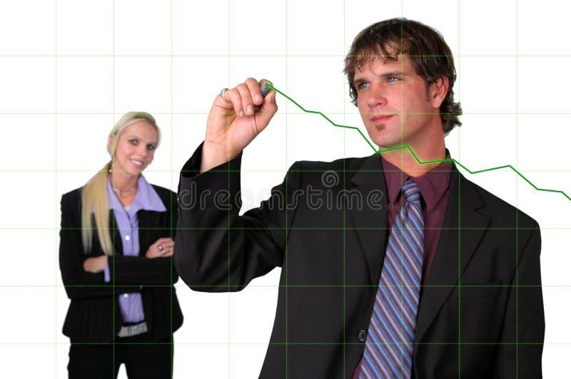 绘制增长图表的生意人 免版税库存图片