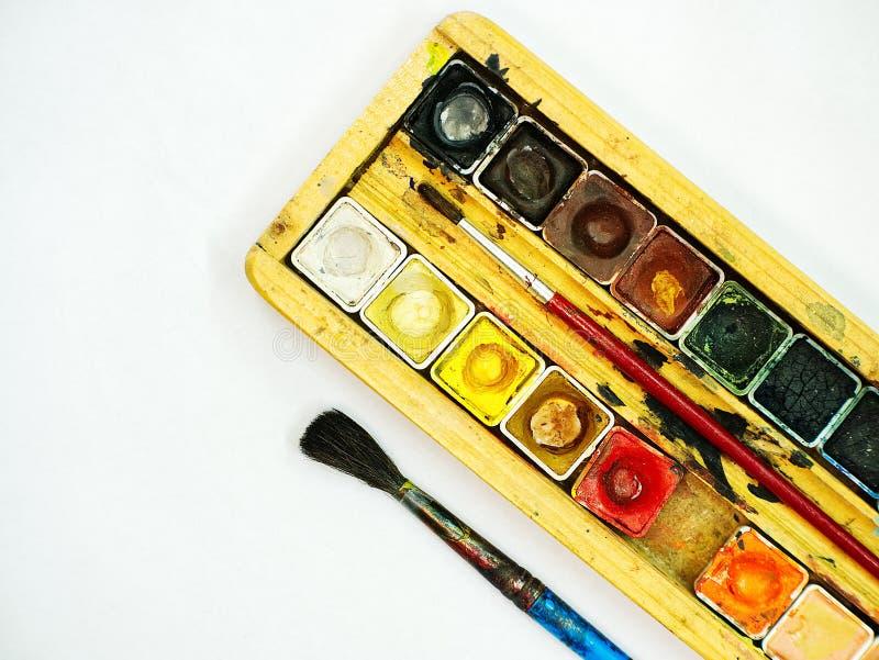 绘在木案件的水彩成套工具 库存照片