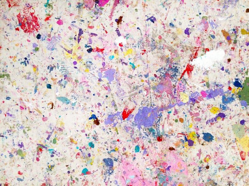 绘在油漆保护板料地毯的下落污点 库存照片