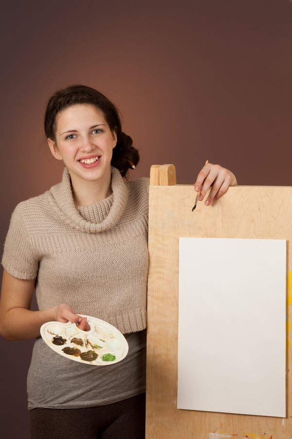 绘画的女孩少年 图库摄影