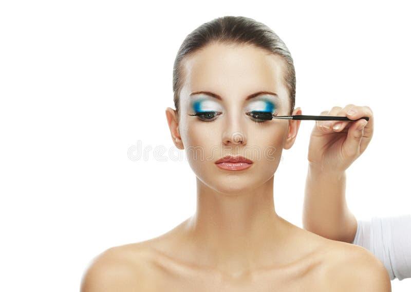 绘美丽的少妇的眼睛 免版税库存图片