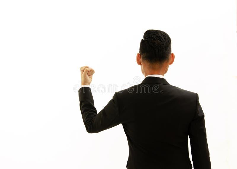 给亚洲商人后侧方的拳头姿态左手 E 免版税图库摄影